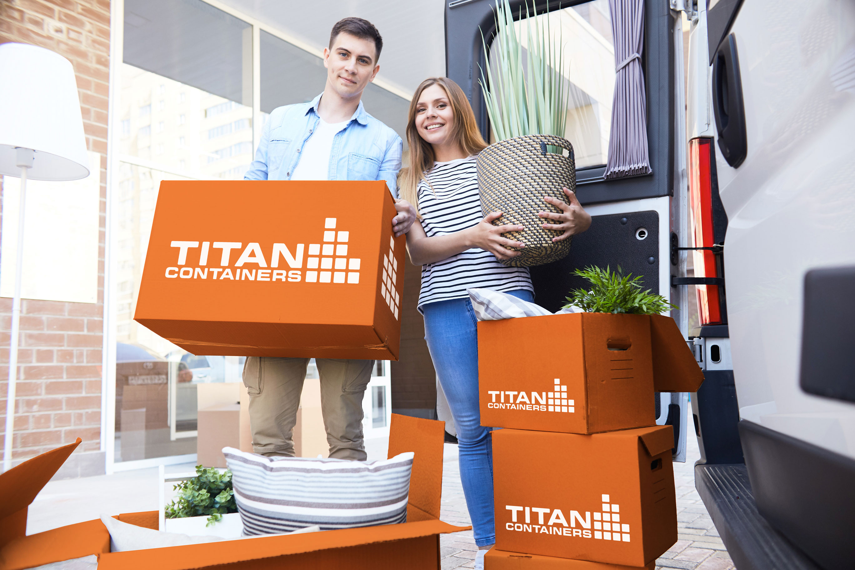 couple-with-TITAN Container Self Storage boxes
